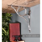 Scrolled Bright Chrome Shelf Bracket Holding up a Wooden Shelf
