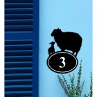Sheep & Lamb Iron House Number Sign on a Blue Wall