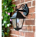 """Sheringham"" Traditional Black Top Fix Wall Lantern in Situ on a Wall"