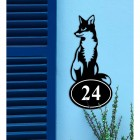 Sitting Fox Iron House Number Sign on a Blue Wall