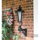 Six Sided Victorian Black Wall Light On Brick Wall