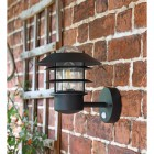 "Side View of the ""Skive"" Black Contemporary Wall Light Mounted on a Brick Wall"