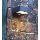 Solar Powered Square Downwards Wall Light in Situ on a Brick Wall