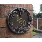 English rose house sign on wall