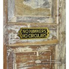 "Side View of the ""No Hawkers No Circulars"" Sign"