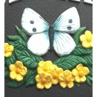 Close up detailed image of hand painted butterfly motif