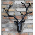 Stag Wall Bust With Gold Birds on a Brick Wall