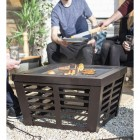 Bronze Contemporary Fire Pit & Grill Being Used on the Patio Outside