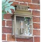 """Stoneford Park"" Antique Brass Half Wall Lantern on a Garden Wall"