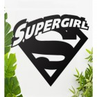 'Supergirl' Wall Art Among Plants in the House