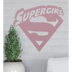 'Supergirl' Wall Art on a White Brick Wall