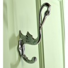 Bright Chrome Swan Coat Hook on a Green Surface