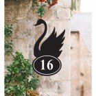 Bespoke Swan Iron House Number Sign on a Garden Wall