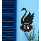 Iron Swan House Number Sign in Situ on a Blue Wall