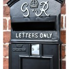 Close-up of the Letter Aperture on the The King George Post Box Slim In Black