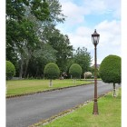 """""""The Ruxton"""" Bronze Manor Style Garden Lamp Post in Situ on a Driveway"""