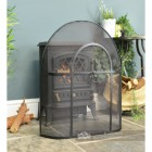 Traditional Black Arched Spark Guard In Living Room Setting