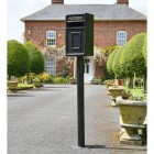 Traditional Black & Gold Post Box and Stand in Situ in Front of a House