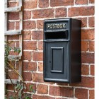 Traditional Black & Gold Wall Mounted Post Box Mounted on a Brick Wall