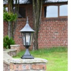 Traditional Black Tinted Pillar Light on a Brick Wall