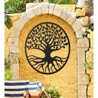 "Black Round ""Tree of Life"" Wall Art on a Yellow Garden Wall"