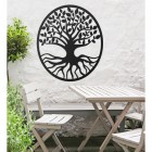 "Black Round ""Tree of Life"" Wall Art Above a Table and Chair Set"