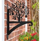 Pear Tree Hanging Basket Bracket on a Brick Wall in the Garden