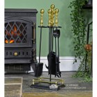 """""""Abbotsford"""" Traditional Companion Set in Black and Polished Brass Next to a Green Wall"""
