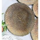 Close up of circular piece showing texture