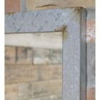 Close up of corner of mirror with rustic finish