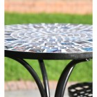 Side view of mosaics on table