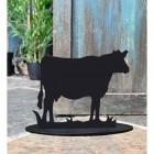Cow Iron Door Stop Next to a Rustic Blue Door