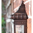 Side view of ornate detailing on half wall lantern