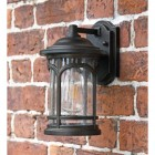 Angled view of bronze wall light in situ