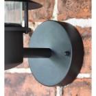 Close up of circular wall mounted bracket