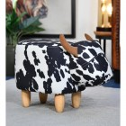 Belle the Black & White Cow Foot Stool in Living Room Setting
