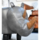 Close up of grey leatherette and brown horns on foot stool