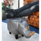 Ruby the Rhino used as a foot stool