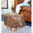 Biscuit the Brown Cow Foot Stool in Living Room