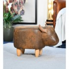 Side view of Biscuit the Brown Cow Foot Stool in Situ