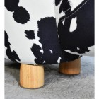 Close up of wooden leg on foot stool
