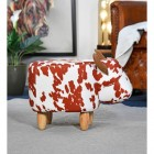 Side view of Cow Foot Stool, Brown and White