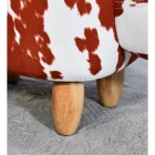 Close up of wooden legs on foot stool