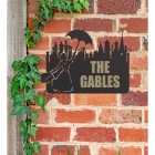 Mary Poppins Iron House Name Sign in Use on a Brick Wall