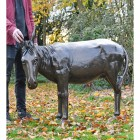 Donkey sculpture situated in garden