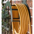 Side View of the Wall Mounted Contemporary Cockerel Iron Hose Holder Mounted to a Brick Wall
