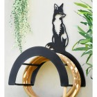 Wall Mounted Sitting Fox Iron Hose Holder Mounted to a Grey Garden Wall