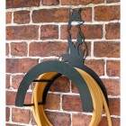 Wall Mounted Sitting Fox Iron Hose Holder Mounted to a Brick Wall