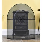 Black Arched Fire Guard In Front Of Stove