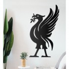 Liver Bird Wall Art on the Wall Next to Plants